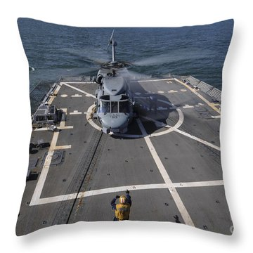 An Sh-60b Sea Hawk Lands On The Flight Throw Pillow by Stocktrek Images