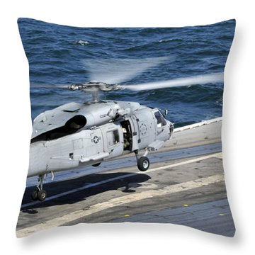 An Sh-60f Sea Hawk Helicopter Lands Throw Pillow