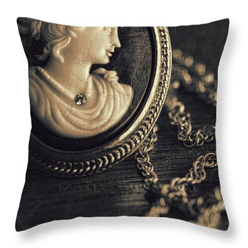 Antique Cameo Medallion On Wood Throw Pillow by Sandra Cunningham