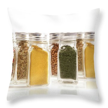 Assorted Spice Bottles Isolated On White Throw Pillow by Sandra Cunningham