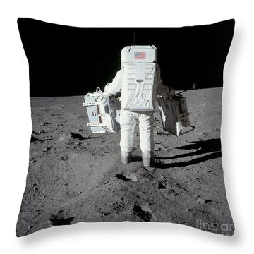Astronaut Carrying Equipment Throw Pillow by Stocktrek Images