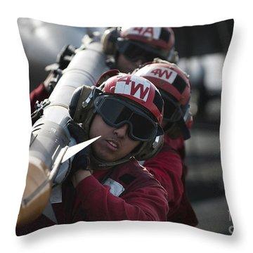 Aviation Ordnancemen Carry An Throw Pillow by Stocktrek Images