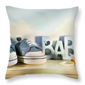 Baby Denim Shoes Throw Pillow by Sandra Cunningham