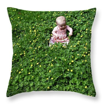 Baby In A Field Of Flowers Throw Pillow