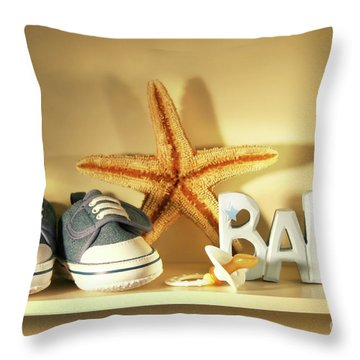 Baby Shoes On The Shelf Throw Pillow by Sandra Cunningham