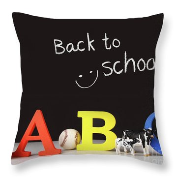 Back To School Concept With Abc Letters Throw Pillow by Sandra Cunningham