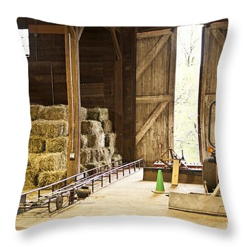 Barn With Hay Bales And Farm Equipment Throw Pillow