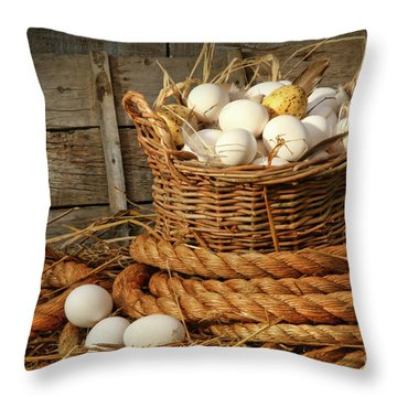 Basket Of Eggs On Straw Throw Pillow by Sandra Cunningham