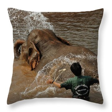 Bath Time In Laos Throw Pillow by Bob Christopher