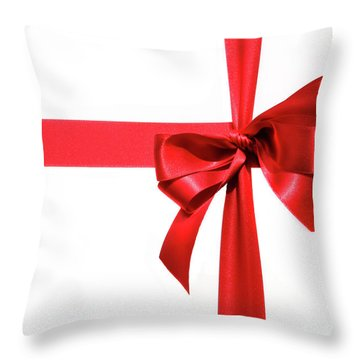 Big Red Holiday Bow On White Throw Pillow by Sandra Cunningham