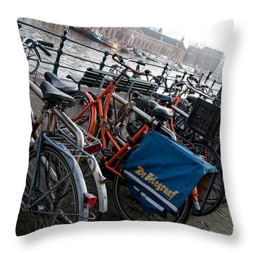 Throw Pillow featuring the digital art Bikes In Amsterdam by Carol Ailles