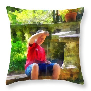 Boy With Yoyo Throw Pillow by Susan Savad