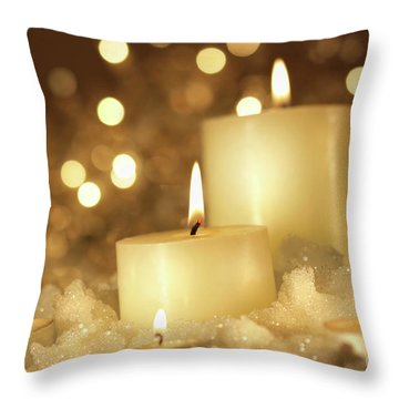 Brightly Lit Candles In Wet Snow Throw Pillow by Sandra Cunningham