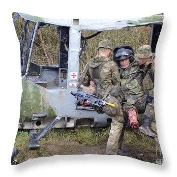 British Soldiers Help A Simulated Throw Pillow by Andrew Chittock