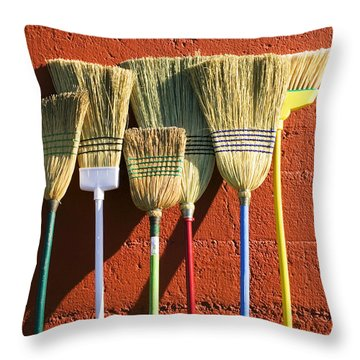 Brooms Leaning Against Wall Throw Pillow