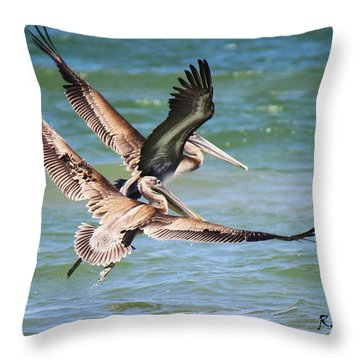 Brown Pelicans Taking Flight Throw Pillow