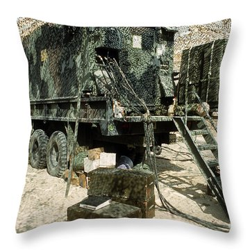 Camouflage Netting Covers A Cargo Truck Throw Pillow by Stocktrek Images