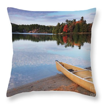 Canoe On A Shore Autumn Nature Scenery Throw Pillow by Oleksiy Maksymenko