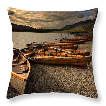 Canoes On The Shore, Keswick, Cumbria Throw Pillow by John Short