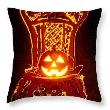 Carved Smiling Pumpkin On Chair Throw Pillow by Garry Gay