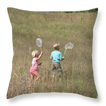 Children Collecting Insects Throw Pillow by Ted Kinsman