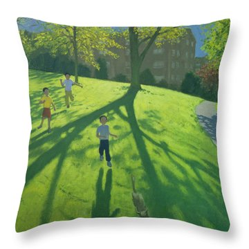 Children Running In The Park Throw Pillow by Andrew Macara