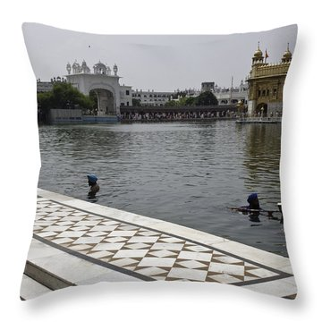 Throw Pillow featuring the photograph Clearing The Sarovar Inside The Golden Temple Resorvoir by Ashish Agarwal