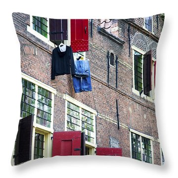 Clothes Hanging From A Window In Kattengat Throw Pillow