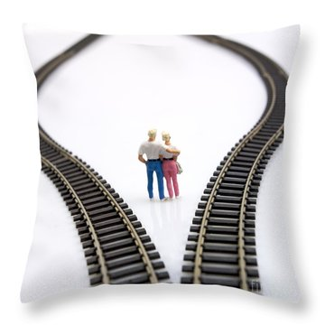 Couple Two Figurines Between Two Tracks Leading Into Different Directions Symbolic Image For Making Decisions Throw Pillow by Bernard Jaubert
