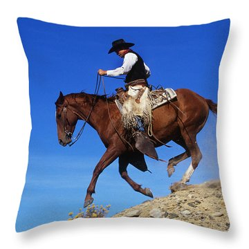 Cowboy Throw Pillow by George D Lepp and Photo Researchers