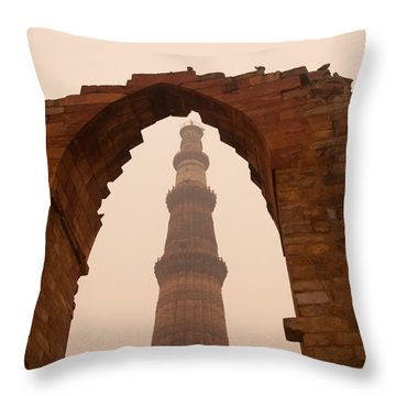Cross Section Of The Qutub Minar Framed Within An Archway In Foggy Weather Throw Pillow by Ashish Agarwal