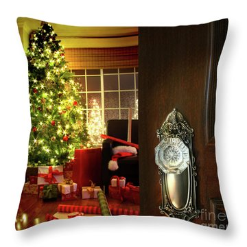 Door Opening Into A Christmas Living Room Throw Pillow by Sandra Cunningham