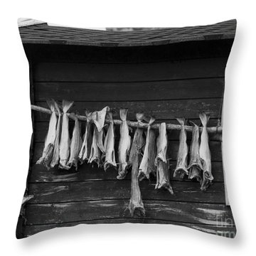 Dried Cod On A Line Throw Pillow by Heiko Koehrer-Wagner
