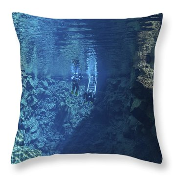 Dry Suit Divers Entering The Gin Clear Throw Pillow by Mathieu Meur