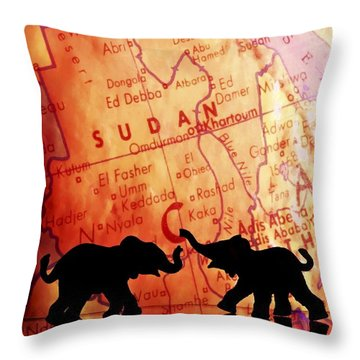 Elephant Silhouettes In Front Of A Map Throw Pillow by Chris Knorr