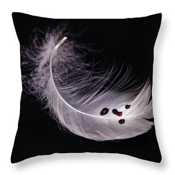 Feather With Blood Throw Pillow by Joana Kruse