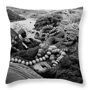 Throw Pillow featuring the photograph Fisherman Sleeping On A Huge Array Of Nets by Tom Wurl