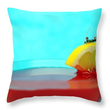 Fishing On A Piece Of Lemon Throw Pillow by Paul Ge