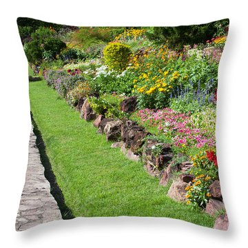 Flowers In Park Throw Pillow by Atiketta Sangasaeng