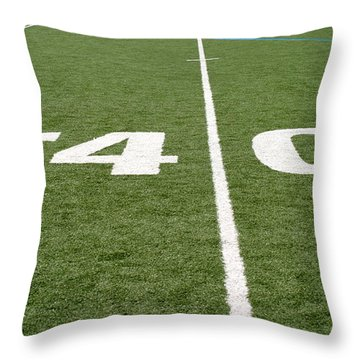 Throw Pillow featuring the photograph Football Field Forty by Henrik Lehnerer
