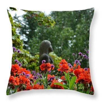 Girl Behind Red Geraniums Throw Pillow