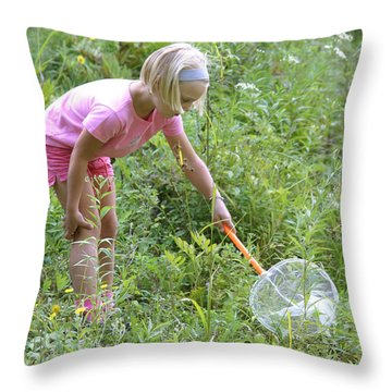 Girl Collects Insects In A Meadow Throw Pillow by Ted Kinsman