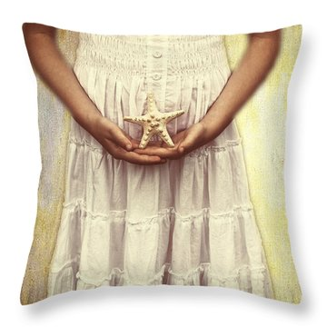 Girl With Starfish Throw Pillow by Joana Kruse