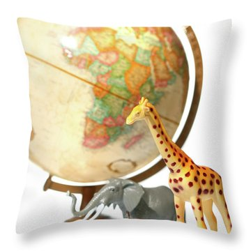 Globe With Toys Animals On White Throw Pillow by Sandra Cunningham