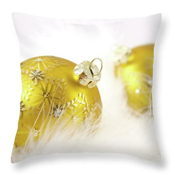 Gold Balls With Feathers Throw Pillow by Sandra Cunningham