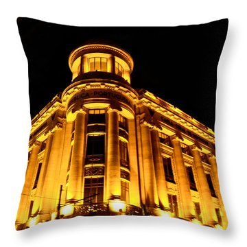 Golden Building At Night Throw Pillow by Kirsten Giving
