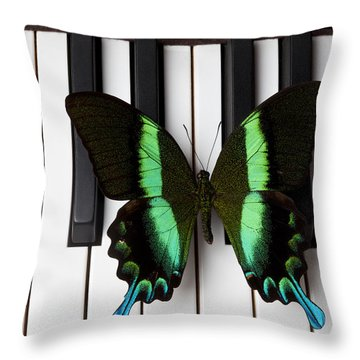 Green And Black Butterfly On Piano Keys Throw Pillow by Garry Gay
