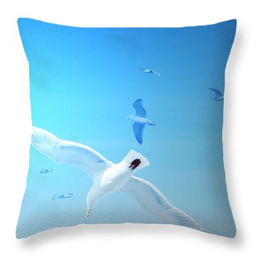 Gulls In Flight Throw Pillow by Michele Cornelius