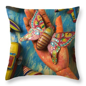 Hand Holding Butterfly Toy Throw Pillow by Garry Gay