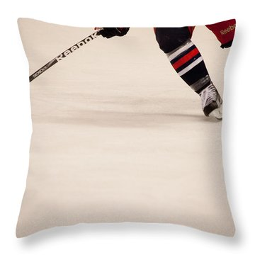 Hockey Stride Throw Pillow by Karol Livote